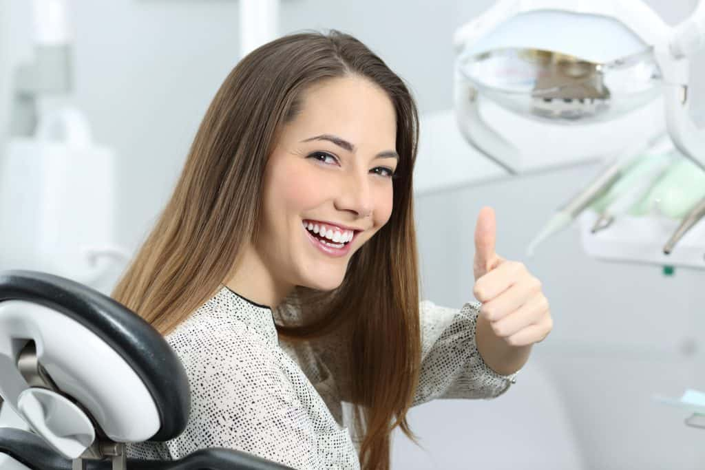 no hassle dentistry happy dental patient thumbs up image